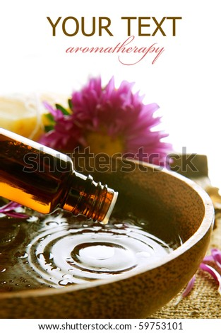 Aromatherapy.Essential oil isolated on white.Spa treatment - stock photo