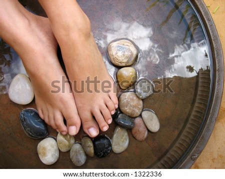 Aromatherapy foot treatment. - stock photo