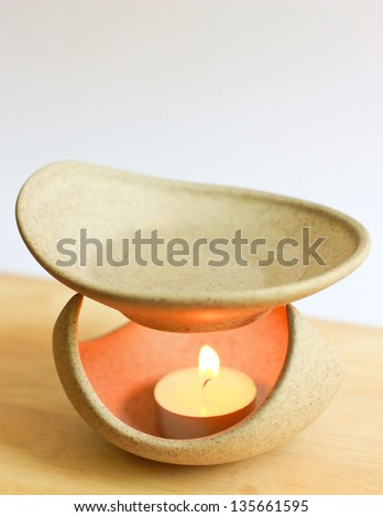 Aromatherapy lamp and candle - stock photo