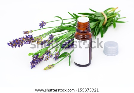 Aromatherapy Lavender oil and lavender flower, isolated on white background - stock photo