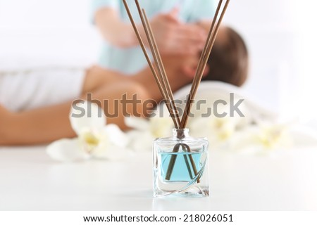 Aromatherapy, medicine east, natural medicine .Attractive brunette woman in spa salon  - stock photo