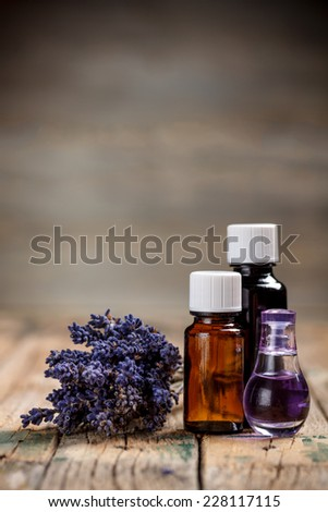 Aromatherapy oil and lavender flower - stock photo