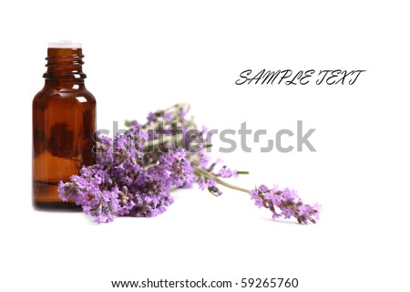 Aromatherapy oil and lavender flower isolated on white background - stock photo