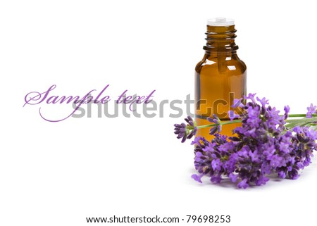 Aromatherapy oil and lavender flowers isolated on white background - stock photo