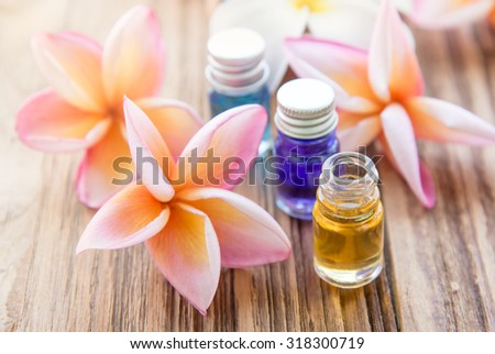 Aromatherapy oil for spa with Plumeria flower on wood background,soft focus - stock photo