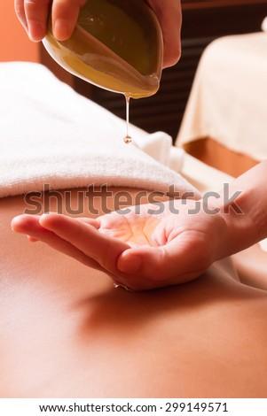 Aromatherapy oil massage - stock photo
