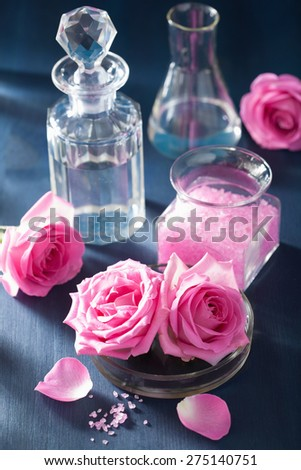 aromatherapy set with rose flowers salt and flasks  - stock photo