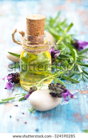 Aromatherapy spa background with a sprig of fragrant lavender with essential oil. - stock photo
