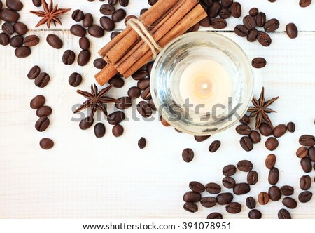 Aromatherapy tea-light candle with coffee and cinnamon aroma, scattered on table. Make your home smell amazing. - stock photo