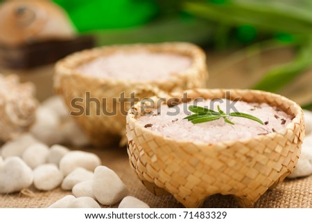 Aromatic bath salt in rustic straw bowls - stock photo