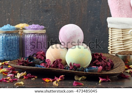 aromatic bath sea salt in glass jar and balls grey background