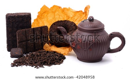 Aromatic black pu-erh tea from yunnan province in China. Leaves undergoes double fermentation and compresed into diferent forms . Healthy hot drink, natural anti-biotic medicine. - stock photo