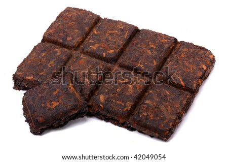 Aromatic black pu-erh tea from yunnan province in China. Leaves undergoes double fermentation and compressed into bricks. Healthy hot drink, natural anti-biotic medicine. - stock photo