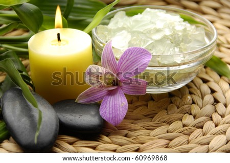 Aromatic candle and spa accessories - stock photo