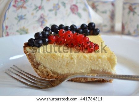 Aromatic cheesecake with fresh summer berries.  Tasty healthy dessert with blueberry and red currant. Soft focus. - stock photo