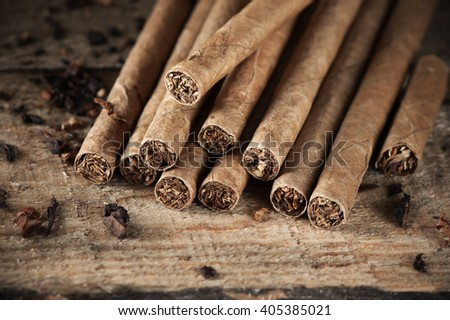 Aromatic cigars pile on vintage wood close-up. - stock photo