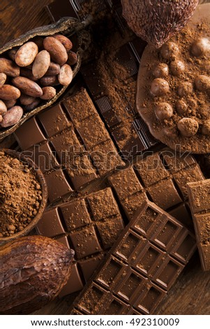 Aromatic cocoa and chocolate on wooden background