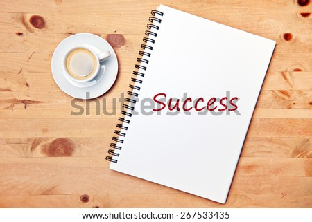 aromatic coffee on wood table - success - stock photo