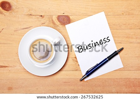 aromatic coffee on wood table with notepad and pen - business