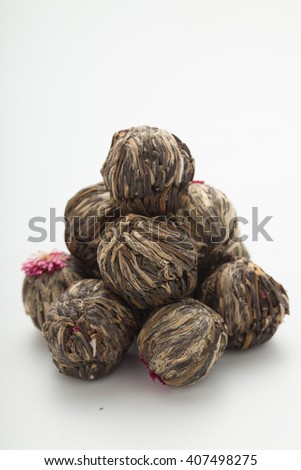 Aromatic flower green tea ball/ blooming tea on white background - stock photo