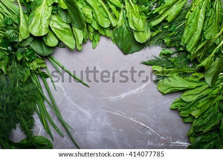 Aromatic fresh herbs from garden lay flat from above. Detox, diet or healthy food concept - stock photo