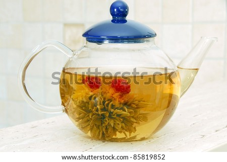 aromatic green tea flower in glass pot - stock photo