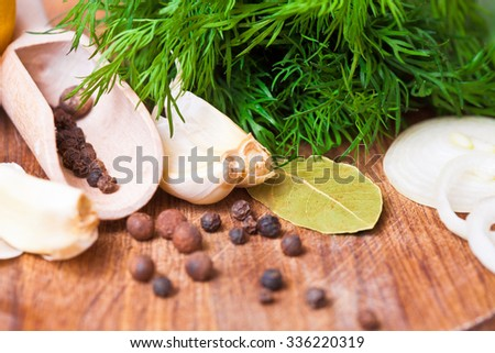 Aromatic herbs and spices on a table close-up - stock photo