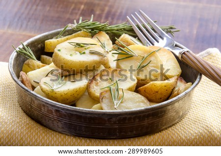Aromatic herbs roasted potatoes with rosemary - stock photo
