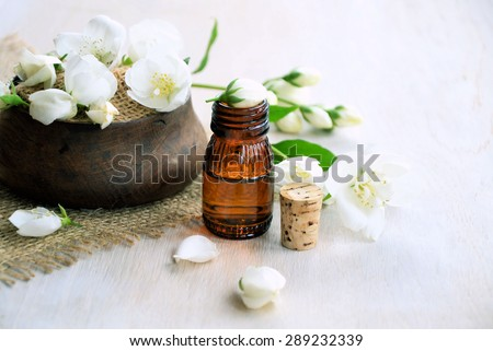 aromatic jasmine oil on a wooden background