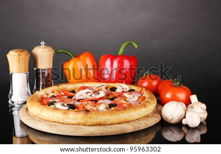 Aromatic pizza with vegetables and mushrooms isolated on black - stock photo