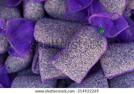 Aromatic pouch with lavandula flowers. Lavender flowers in purple mesh pouches in order to provide an aromatic sachet. Photographed in Provence region. - stock photo