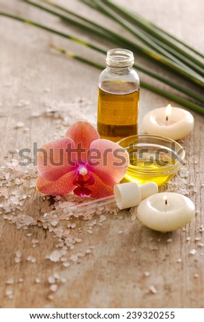 Aromatic spa set with candle , orchid,, candle and oil with pile of salt,  - stock photo