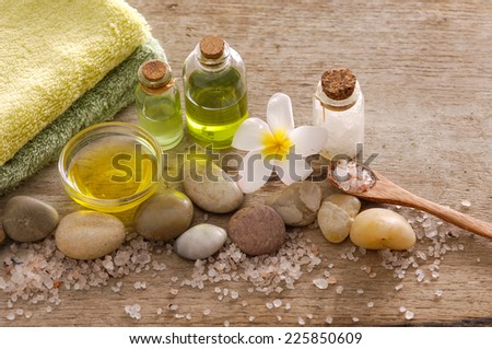 Aromatic spa set with candle , tropical flower, candle and ball with pile of salt,  - stock photo