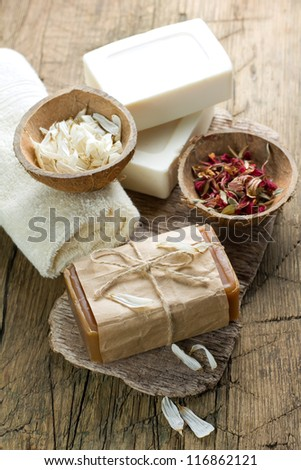 Aromatic spa set with soap and herbs - stock photo