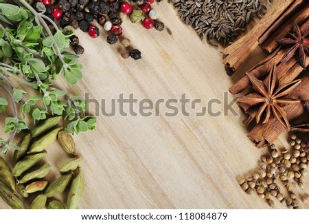 Aromatic spices and herbs on wooden background - stock photo