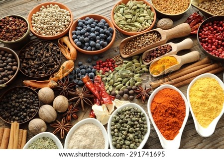 Aromatic spices in metal and ceramic bowls.