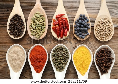 Aromatic spices on wooden spoons. Food ingradients.