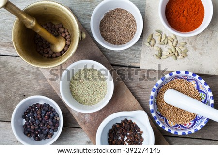Aromatic spices on wooden table. Food ingredients. - stock photo
