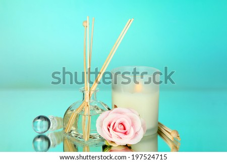 Aromatic sticks for home with floral odor on blue background - stock photo