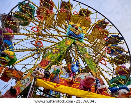 ARONA, ITALY - MARCH 5, 2011:  Big colorful wheel in the annual amusement park along the lake Maggiore promenade - stock photo