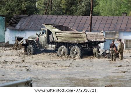 Around Sioni, Georgia - May 12, 2014: Every spring Caucasian river Terek floods Transcaucasian Highway runs between Tbilisi and Vladikavkaz. Terek River is a major river in the Northern Caucasus. - stock photo