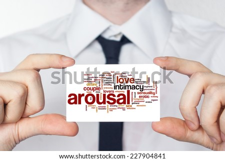 Arousal. Businessman in white shirt with a black tie showing or holding business card - stock photo