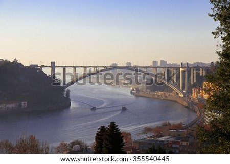 Arrabida bridge and river traffic, Douro river, Porto, Portugal