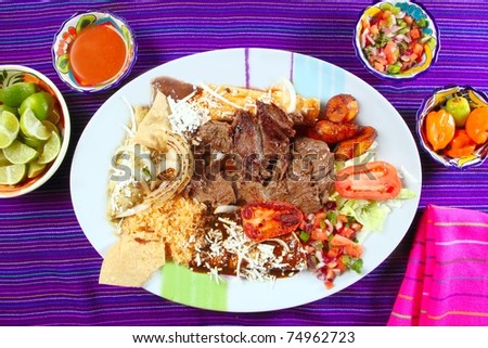 Arrachera beef flank steak Mexican dish assorted chili sauces Mexico spiced - stock photo