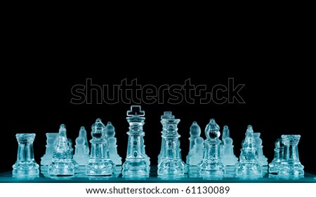 Arranged Chess Pieces in Blue Filter with Space for Text Above - stock photo