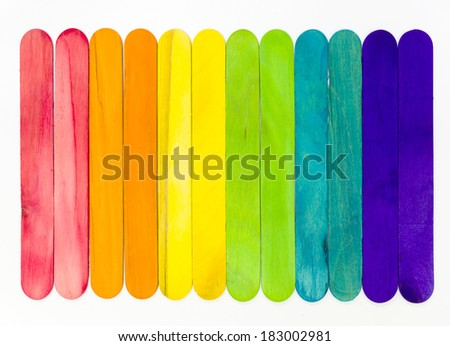 Arranged colorful ice cream sticks on white background