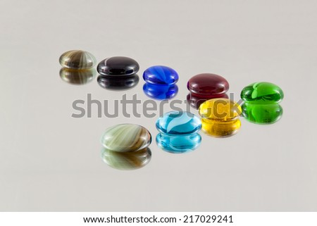 Arranged glass gems with blurred reflections