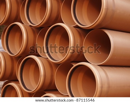 arranged on heap plastic pipes - stock photo