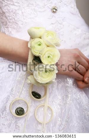 Arrangement. Bouquet of Flowers as a Bracelet on Woman's Hands. Floristics - stock photo