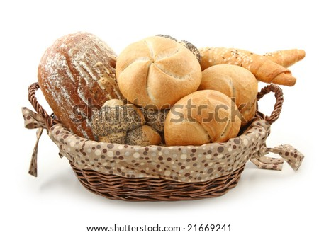 Arrangement of bread in basket isolated on white background - stock photo